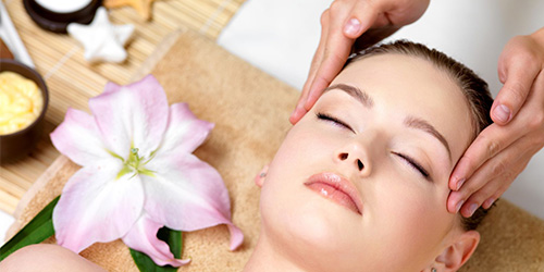 9267831 - beautiful young woman having spa massage of the head  in beauty salon - indoors
