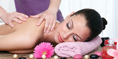 14332524 - young female getting a body massage at the day spa